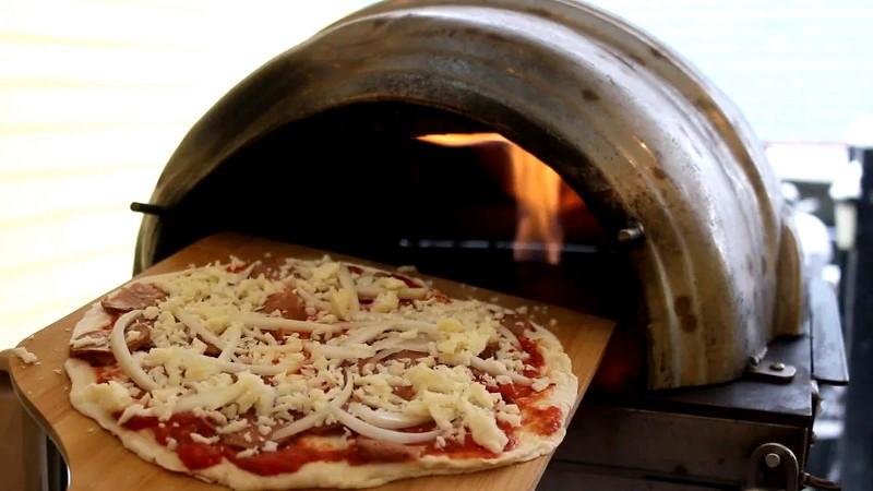 El barril de cerveza se convierte en un horno de pizza de alto rendimiento